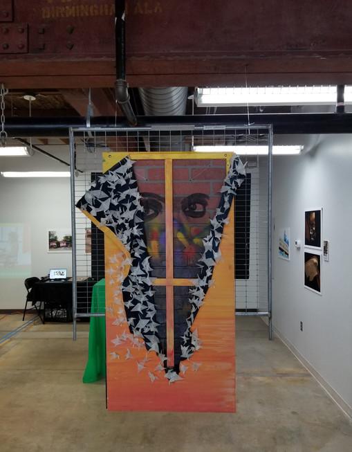 Illartpeace, Released Peace, 2019, Mixed Media on board and 100 paper cranes, 24in x 4ft, Birmingham, AL
