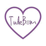 Logo_TudeBom_coração_redondo_manteiga_