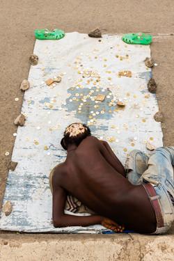 Sleeping street beggar