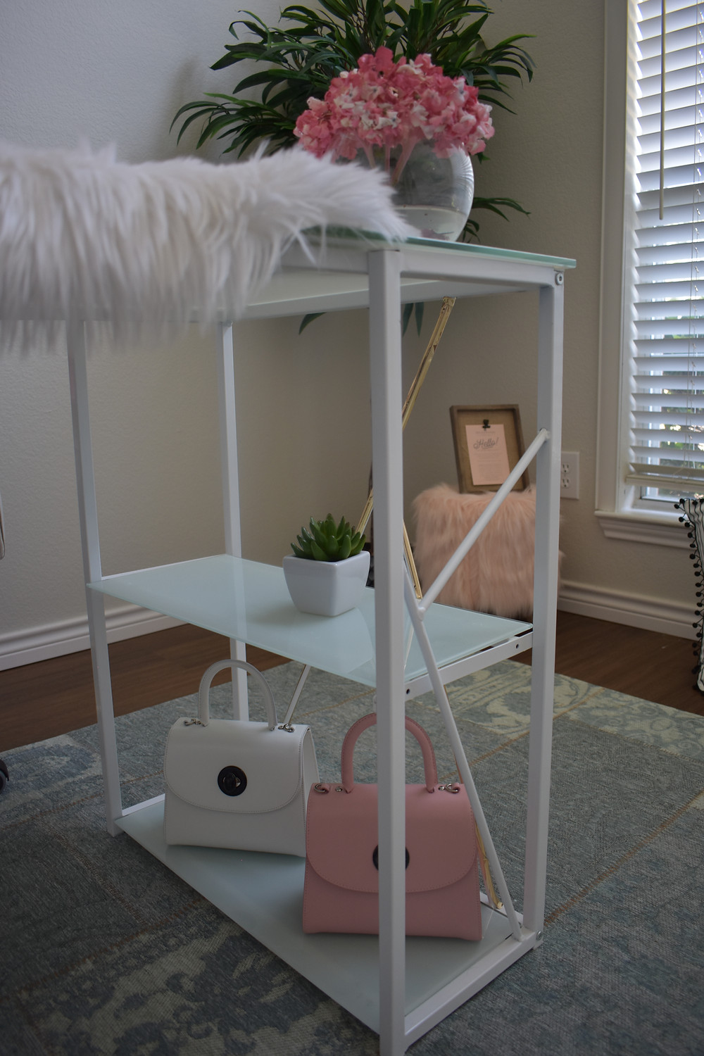 Chic and modern white glass writing desk. I decided to add little gold tape to add a little more style to fit my office decor.