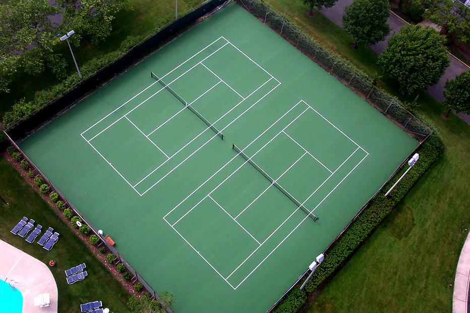 Tennis court repaired.jpg