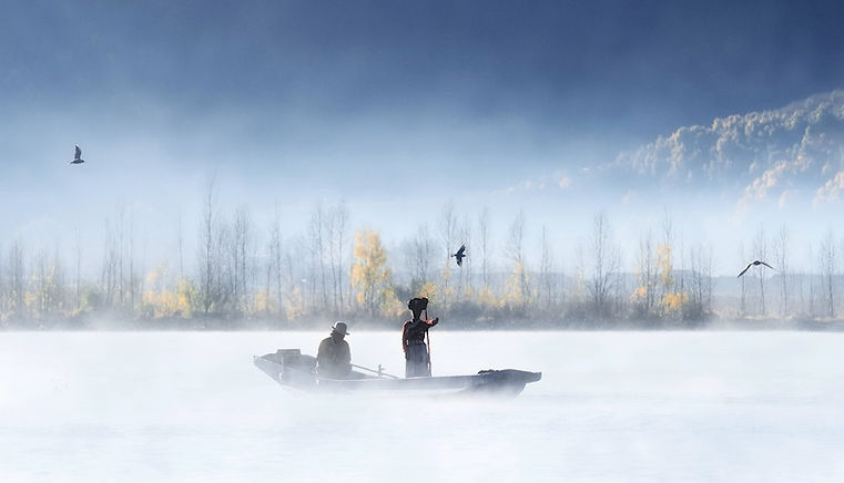 Naxi People Wearing Ethnic Clothes boating on Lugu Lake of Lijiang