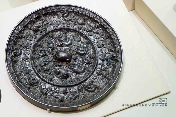 Unearthed Copper Mirror Decorated with Mythical Animals and Grape Patterns