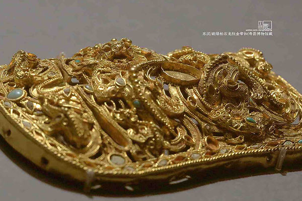 Unearthed Dragon Shaped Golden Belt Buckle of the Eastern Han Dynasty Decorated with Turquoises