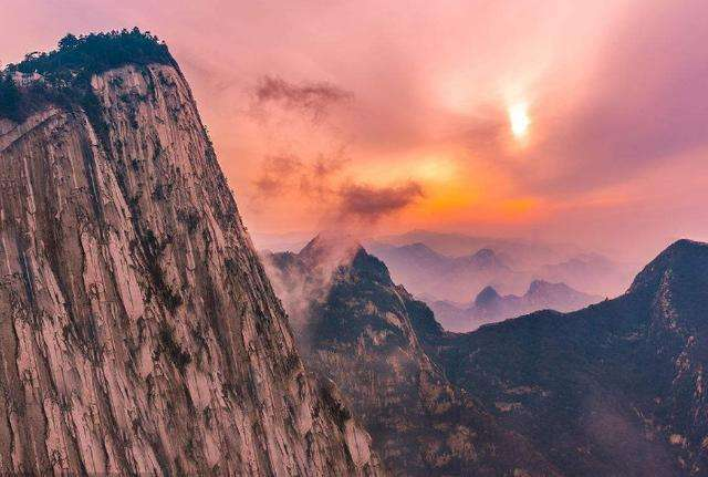 Steep cliff of Mount Hua and Sunset