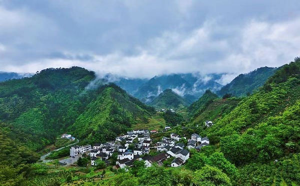 A Village in Huizhou Surrounded by Grand Mountains