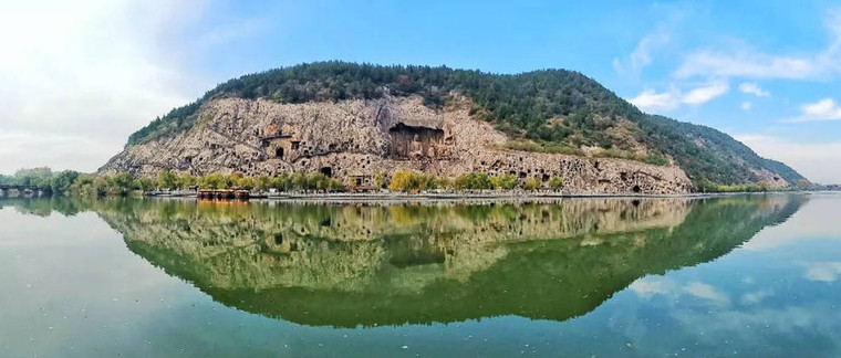 Panoramic of Longmen Grottoes on West Hill, Photo from Official Site of Longmen Caves.