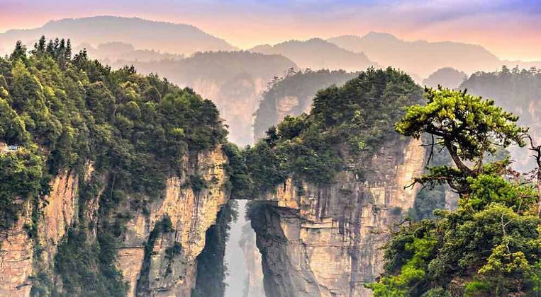 Highest Natural Stone Bridge Connects Two Peaks in Zhangjiajie National Forest Park