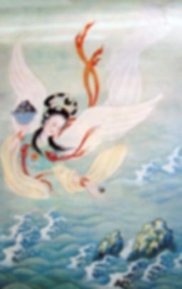 Jing Wei throwing small stones ino the sea