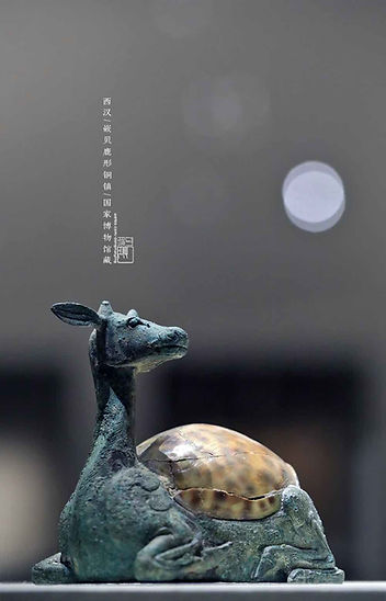 Deer Shaped Bronze Artifact (Tong Zhen) of the Han Dynasty Decorated with Shell that was used to Press Sitting Mat