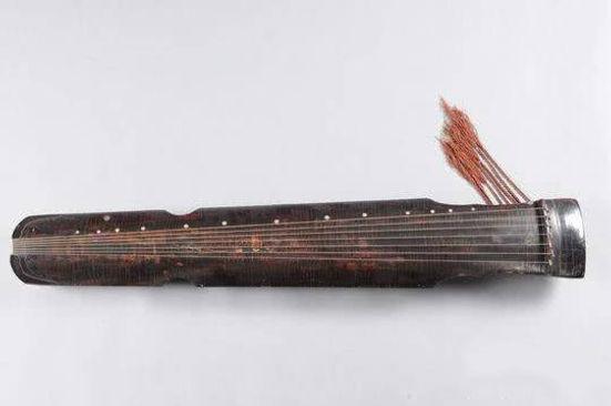 """Musical Instrument Qin named """"Shi Jian Qiao Bing"""" of the Tang Dynasty (618 — 907)"""