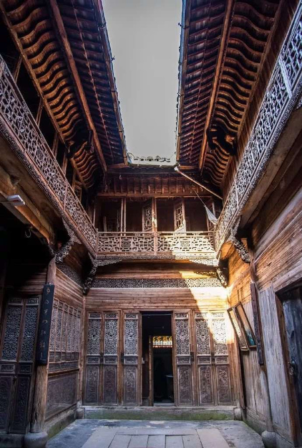 Exquisite Wooden Carvings and Courtyard, or Tianjing, of Ancient Huizhou Buildings.