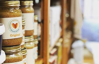homemade almond butter on a shelf at a store