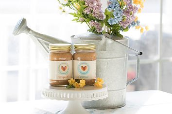 coconut almond butter and original almond butter with natural flower