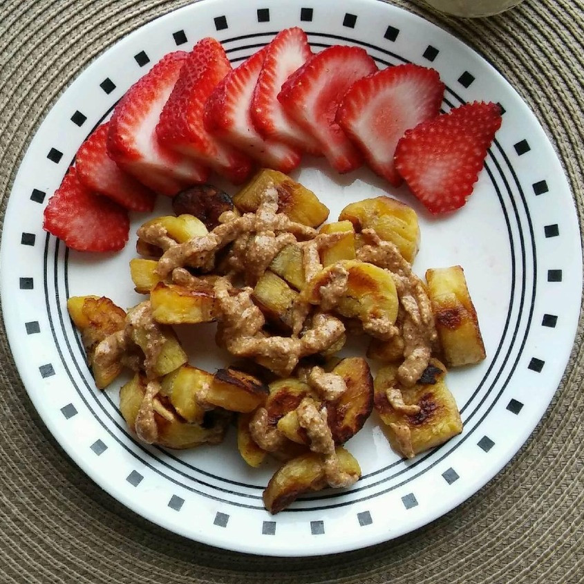 Plantain Chips and strawberries with almond butter drizzle