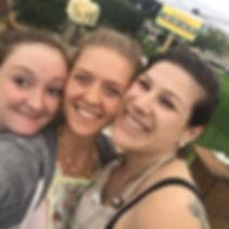 Kiana, Ashley and Beckah at a farmers' market.