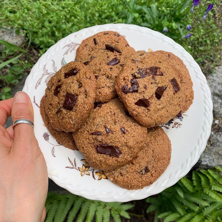 Chocolate chip almond butter cookies on a white plate