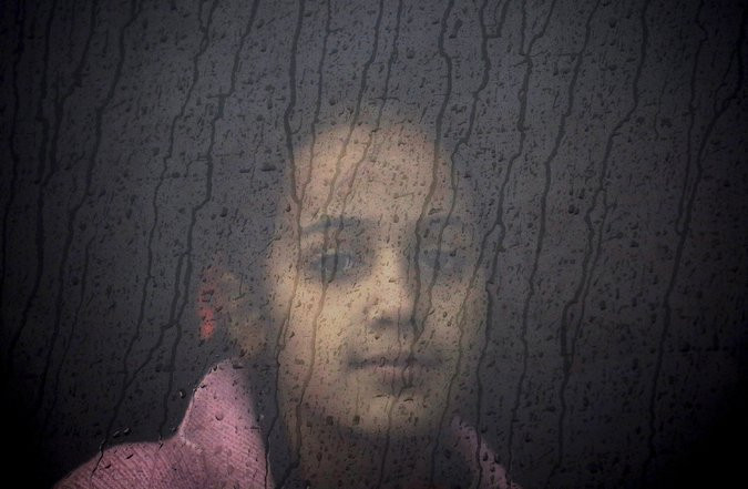 A Syrian refugee in Lesbos, Greece. Credit Yannis Behrakis/Reuters