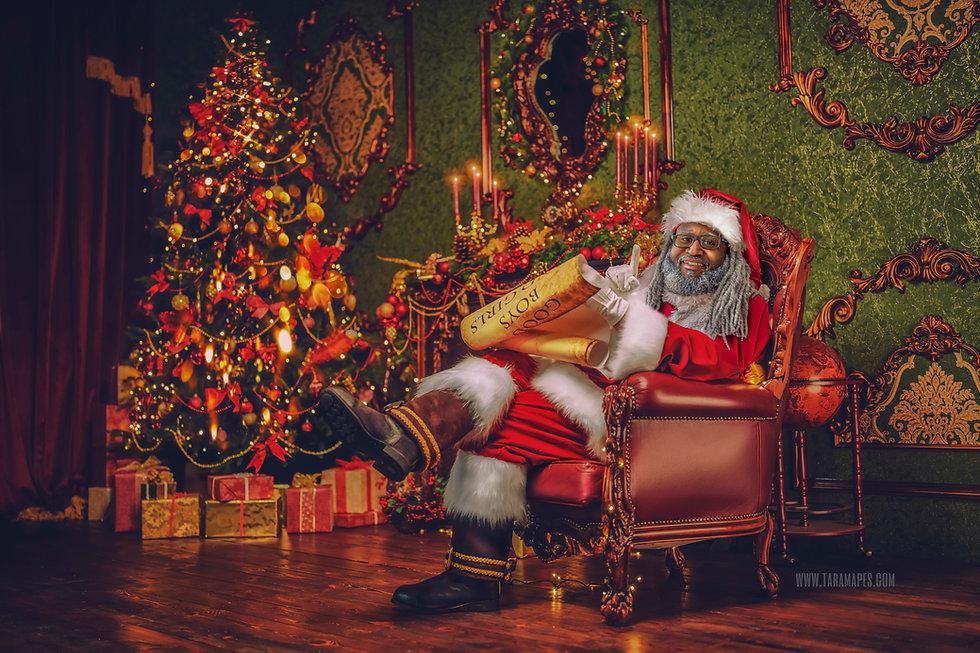 Black Santa in Chair Legs Crossed 2020 v