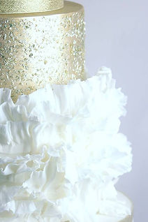 wedding cake, white ruffles, gold, gold sequins, tiered wedding cake