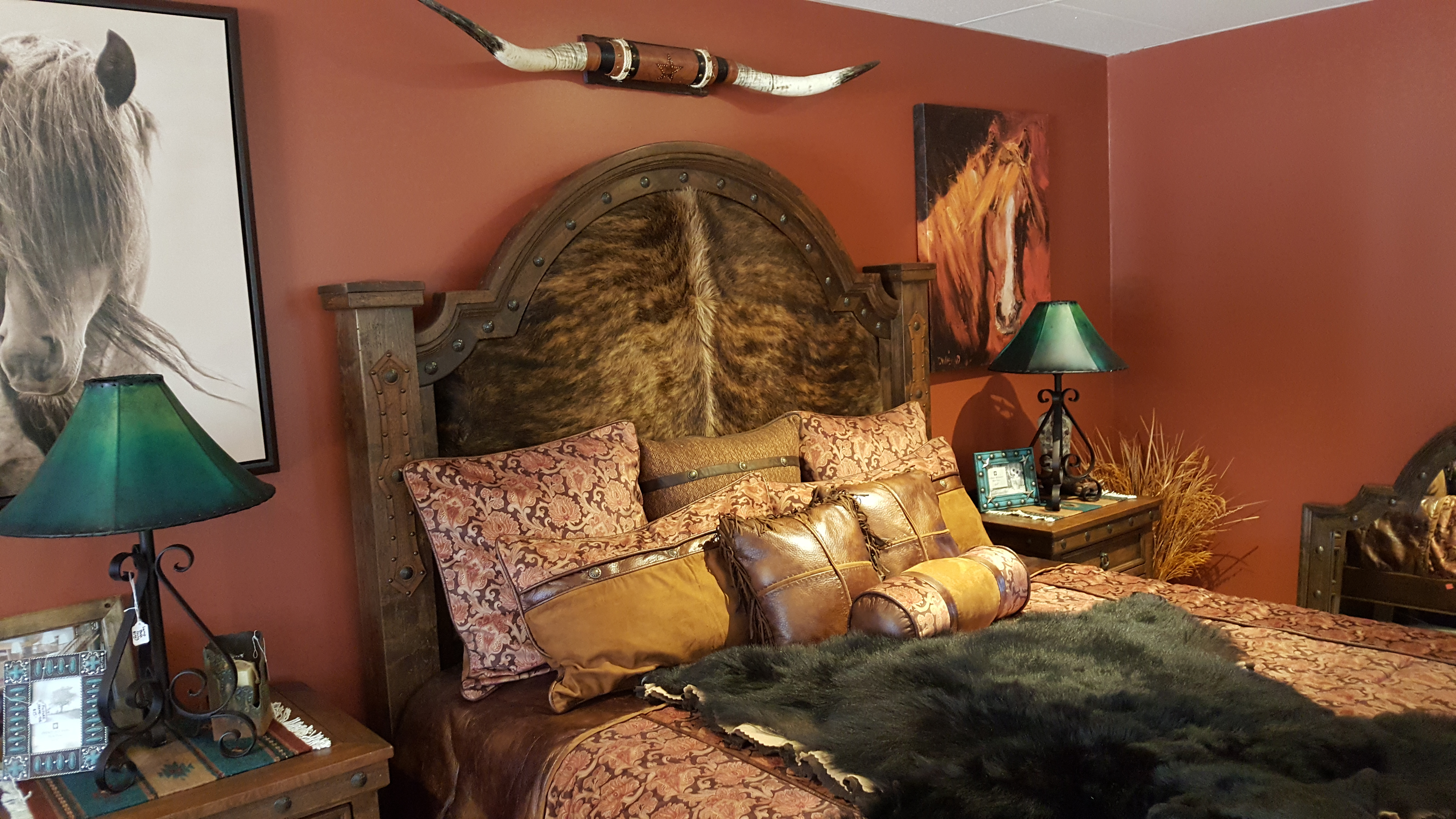 Western rustic bed with cowhide