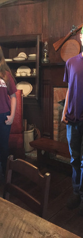 Maddy is the great-great-great-great-great granddaughter of the original owners of the inn.  She and her friend Adam are student volunteers at the farm, along with a number of other middle and high school students. They are standing in one of the main rooms of the inn.