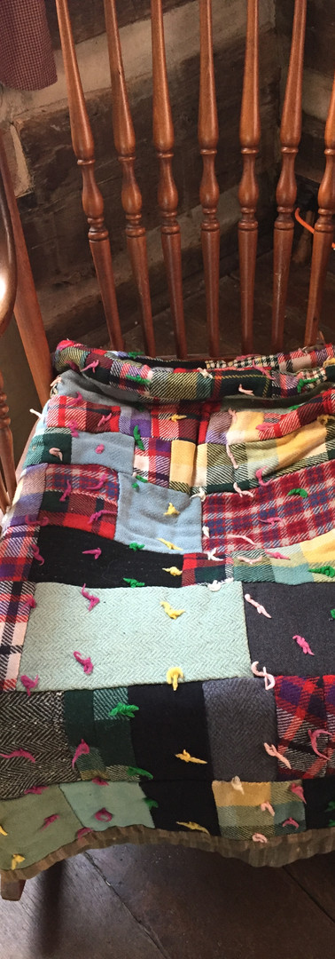 My mother has a very similar quilt made by my great grandmother of her husand and sons' worn out suits