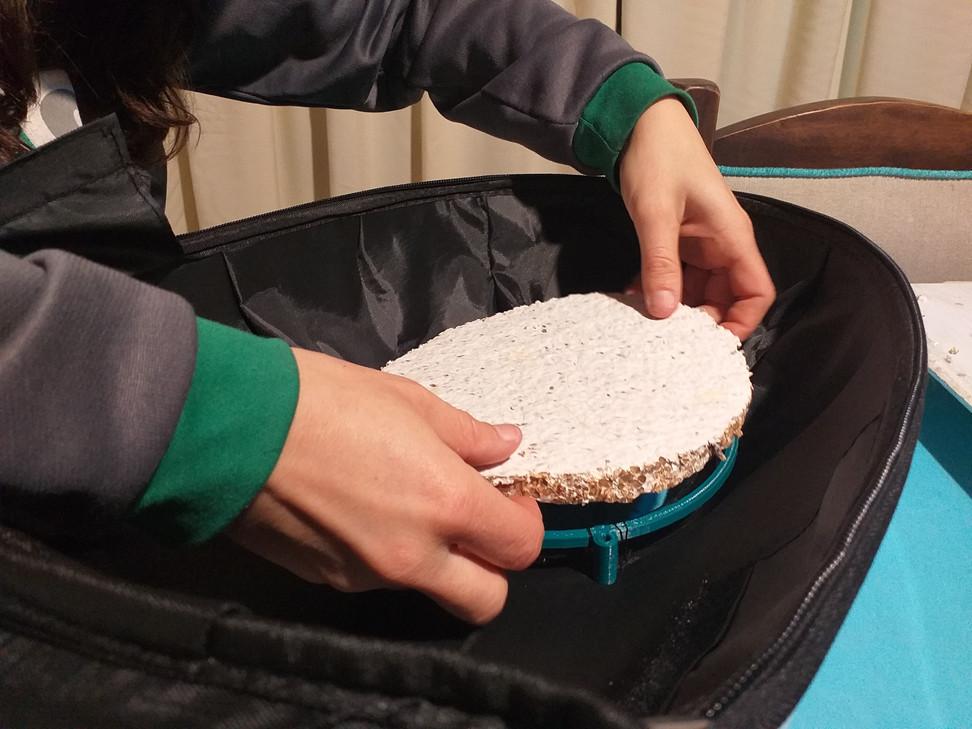 Colocación del disco en la mochila