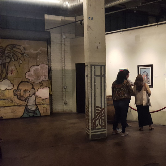 A couple admiring the artwork