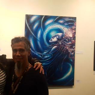 Artist Benedigital in front of his piece
