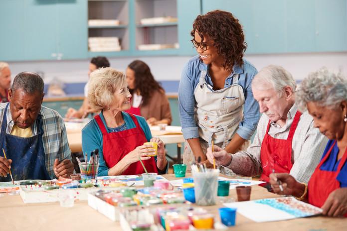 group-of-retired-seniors-attending-art-c