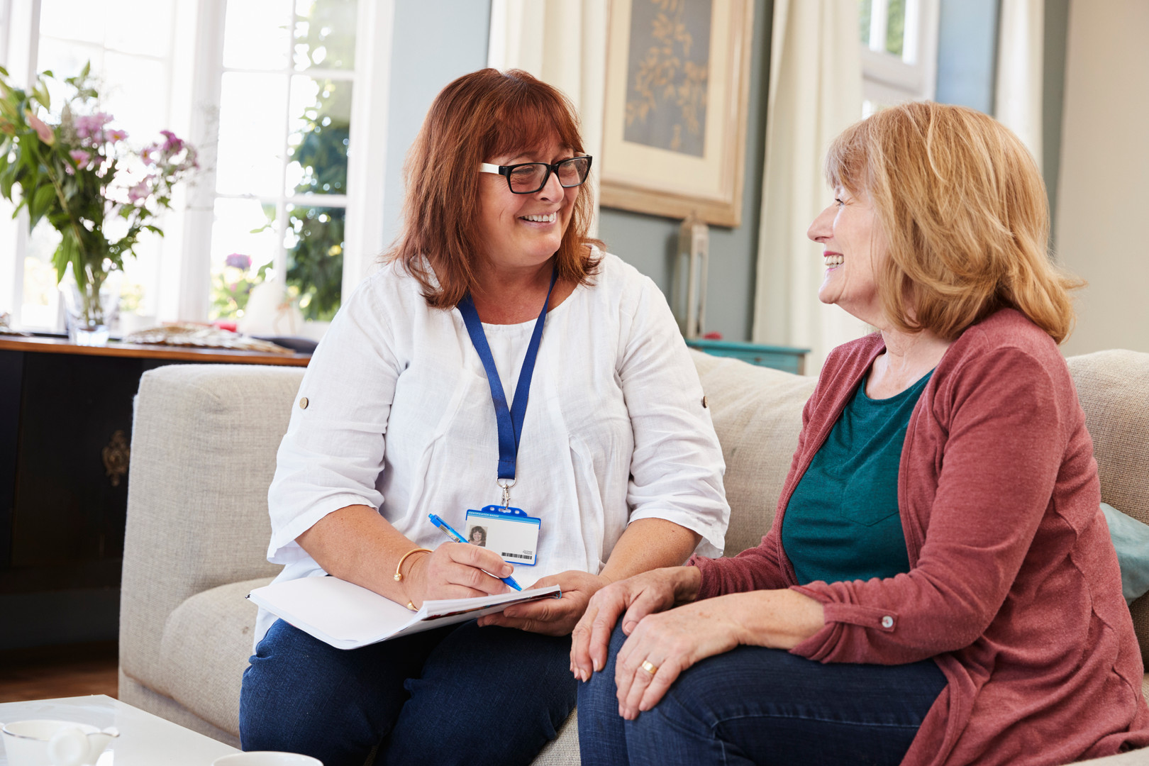 female-support-worker-visits-senior-woma