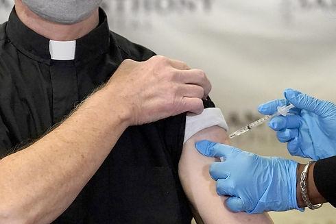 priest and vaccine.jpeg