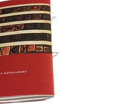 Broschüren geheftet Rückenstichheftung drucken Aachen Druckerei Ringösenheftung