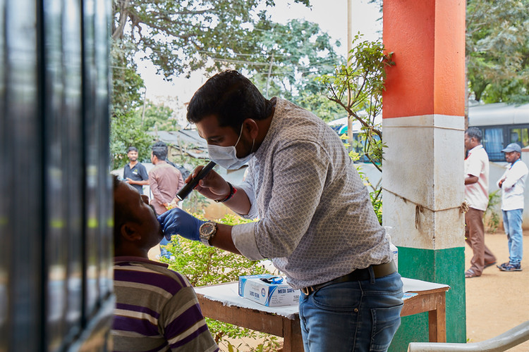 Specially trained doctors screening the villagers for cancer