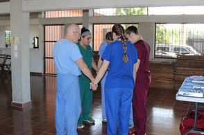 Dr Livingston praying with team (2).JPG