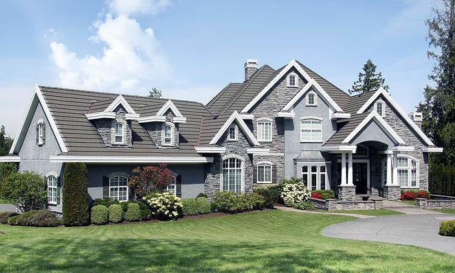 Beautiful luxury mansion with manicured front lawn. .jpg