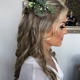Half up half down curls with flower crown