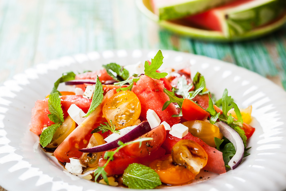 Healthy Salad with Tomatoes, Onions, Lettuce, and Fruit