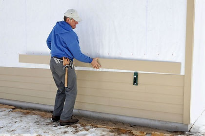 Putting-up-siding-e1449120934870.jpg
