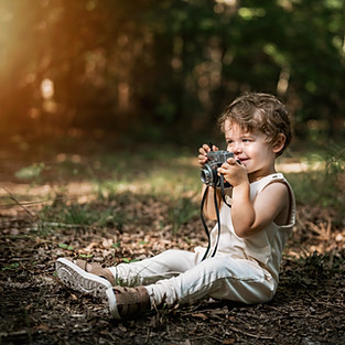 Young Photographer in the Forest