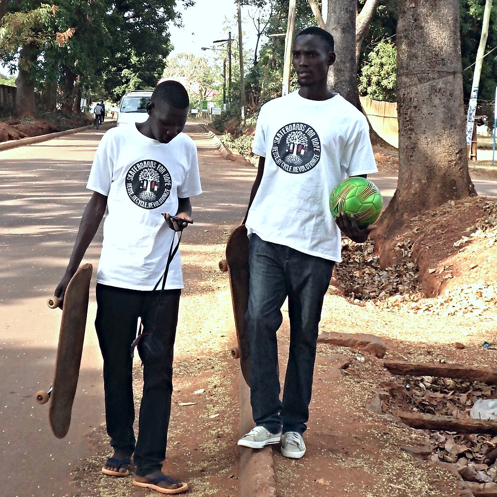 Skateboards For Hope ambassadors heading out to play practice skateboarding and soccer in Gulu, Uganda.