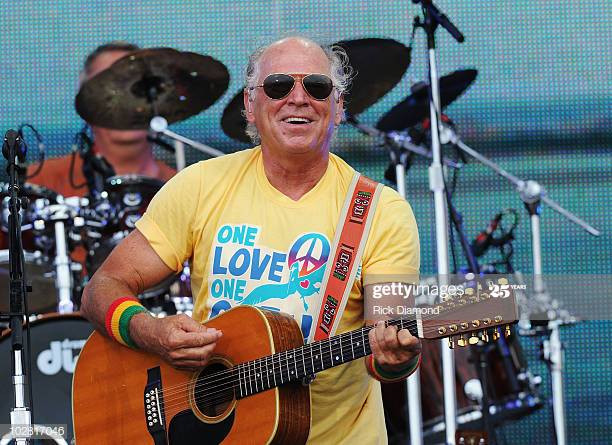 GULF SHORES, AL - JULY 11:  Musician Jimmy Buffett performs onstage at Jimmy Buffett & Friends: Live from the Gulf Coast, a concert presented by CMT at on the beach on July 11, 2010 in Gulf Shores, Alabama.  (Photo by Rick Diamond/Getty Images for CMT)