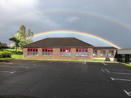 School crowned by a rainbow