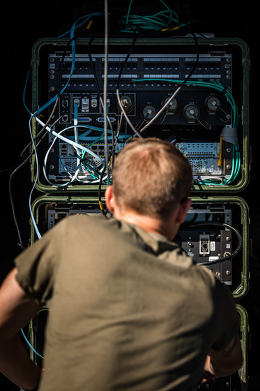 PFC Justin Jones, assigned to the 738th Brigade Signal Company, works on the Command Post Node during Annual Training at Camp Atterbury Joint Maneuver Training Center, IN, Sept. 20, 2020.