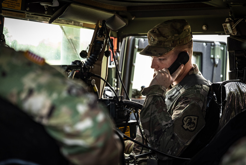 Indiana National Guardsmen, PFC Matthew Neville assigned to the 738th Brigade Signal Company conducts a radio check-in the HMMWV at Camp Atterbury, IN, during Annual Training, Sept. 15, 2020.