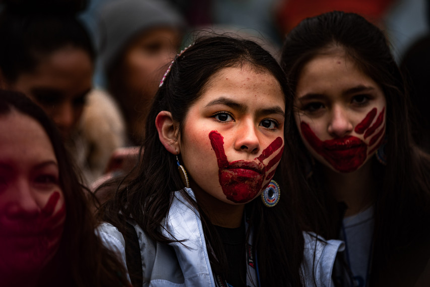 """Other Native American Women from various Tribal Nations throughout the United States attended the Women's March in Washington D.C. on January 18th, 2020. Elise R. White """"Wakinyan Ekta Inajin Win"""" and Josalyn E. White """"Tusweca Luta Win"""" of Oglala Lakota wears the red-hand to represent the Missing and Murder Indigenous Women."""