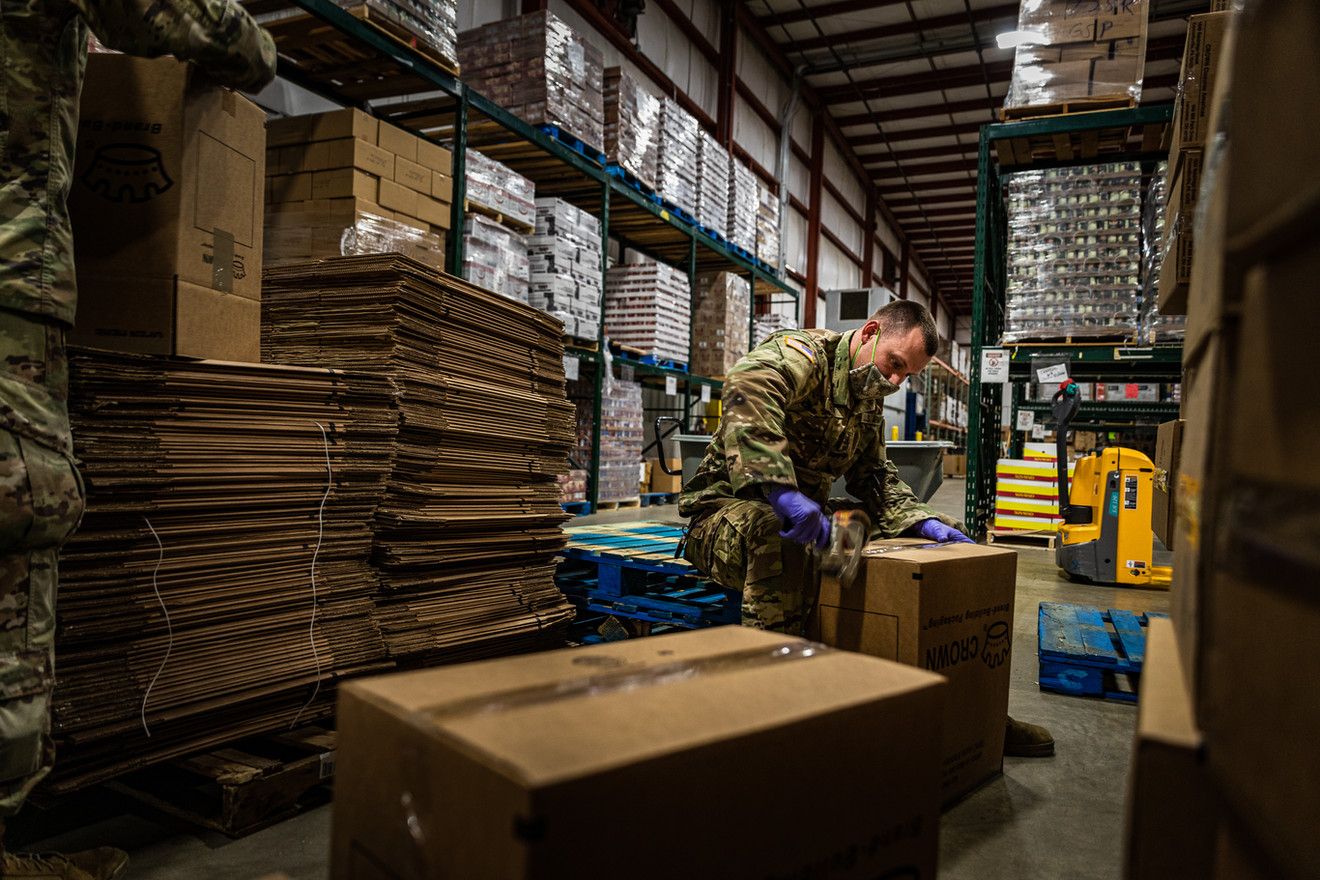 Indiana National Guardsmen SGT Ryan Smith assigned to A Co. 113th BSB prepares boxes to be used as packages of food at the Second Harvest Foodbank of East Central Indiana in Muncie, IN., May 18, 2020. The Indiana National Guard was activated in response to COVID-19. Selected Guardsmen were assigned to different Foodbanks across Indiana and assist them with the growing need of handing out packages of food, due to COVID-19.