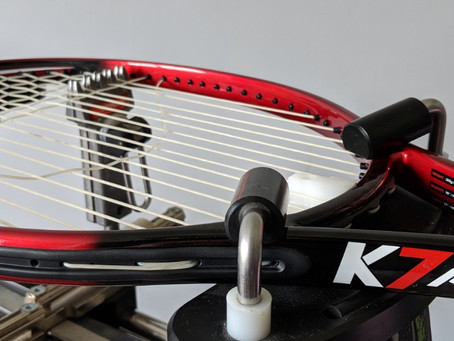 A Guide to Tennis Racket Restringing