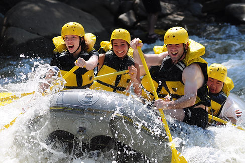 Friends taking a rafting trip through the Youghiogheny River rapids